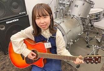 スタッフ写真ギター・デジタル製品鬼塚