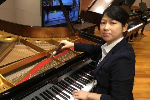 スタッフ写真ピアノ調律師山田