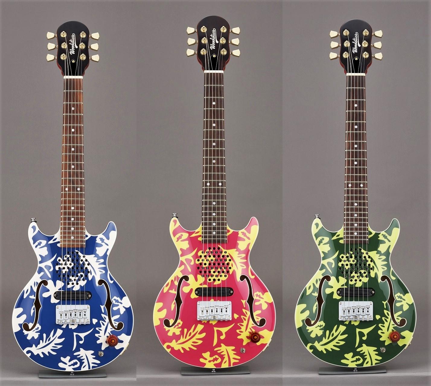 横山健プロデュース&監修で話題のブランド、Woodstics Guitarsが遂に始動。第一弾は、ESP助六と同じボディシェイプのミニギターで、ボディトップにはハイビスカスのアロハ柄がペイントされ、鮮やかな3色がラインナップしています。  ボディにはスピーカーを内蔵、アンプに繋がなくてもすぐにエレキギターサウンドを楽しむことが可能。また、ミニスイッチをオンにすれば、心地よいディストーションサウンドに変化、いつでもどこでもロックなサウンドでプレイできます。
