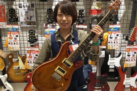 スタッフ写真ギターアクセサリー吉田